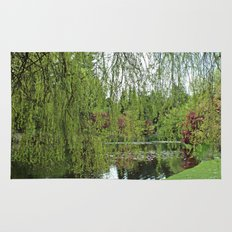 Lovely, soft green spring willow tree by the pond Rug