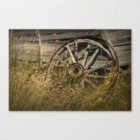 Broken Wheel of a Farm Wagon in the Grass on the Prairie Canvas Print