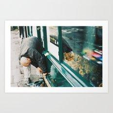 Man working on store front, quai Voltaire, Paris 2012 Art Print