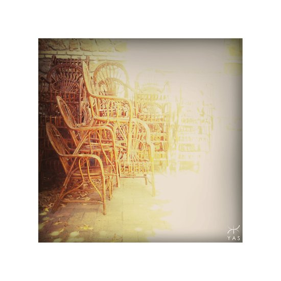 Old chairs stacked and light Art Print