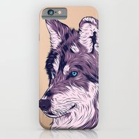 iPhone Cases featuring Blue eyed wolf by Roland Banrevi