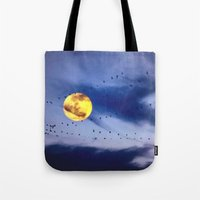 On a left along the moon and further to the east. Tote Bag