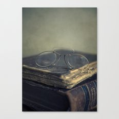 Old glasses and pile of old books Canvas Print