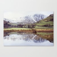Farm and snow covered mountain reflections in Brothers Water. Cumbria, UK. (Shot on film). Canvas Print