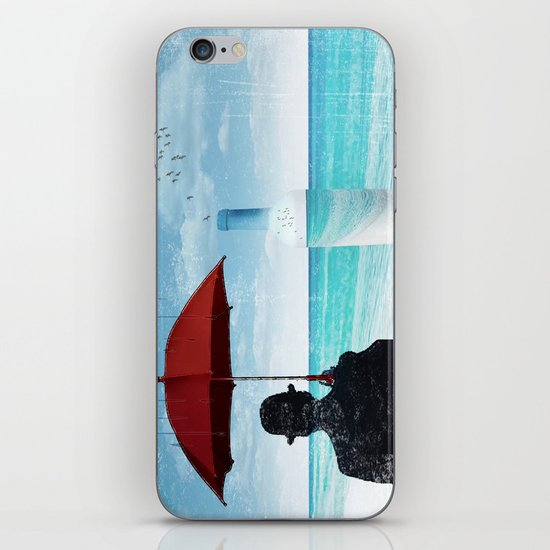 Chaplin at the beach in the rian iPhone & iPod Skin