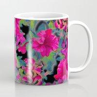 vivid pink petunia on black background Mug