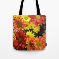 Red, yellow and orange colorful autumn daisy flowers. floral photography. Tote Bag