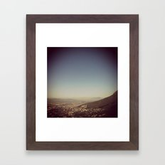 City that sits at the feet of her mountains Framed Art Print