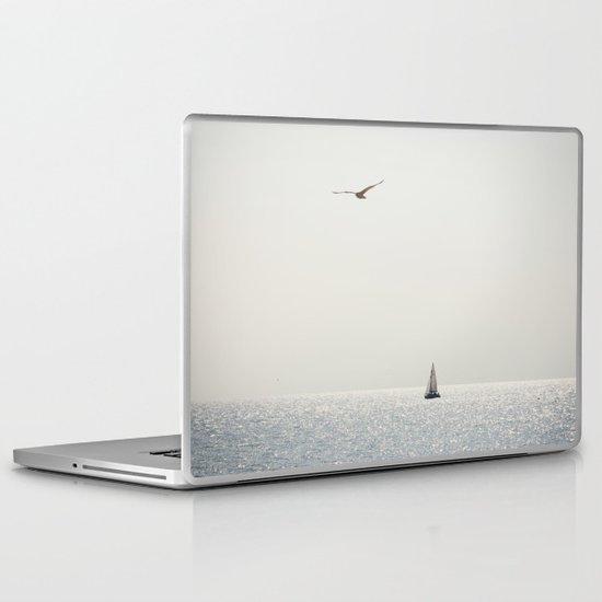 Fly over the sea Laptop & iPad Skin