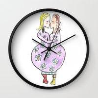 Kissing women in a flower dress Wall Clock