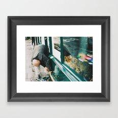 Man working on store front, quai Voltaire, Paris 2012 Framed Art Print