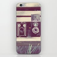 Two Cameras Sitting On A… iPhone & iPod Skin