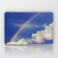 Rainbow over fluffy white clouds in the blue sky Laptop & iPad Skin