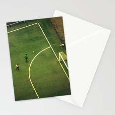 Kids are playing football on the green field Stationery Cards