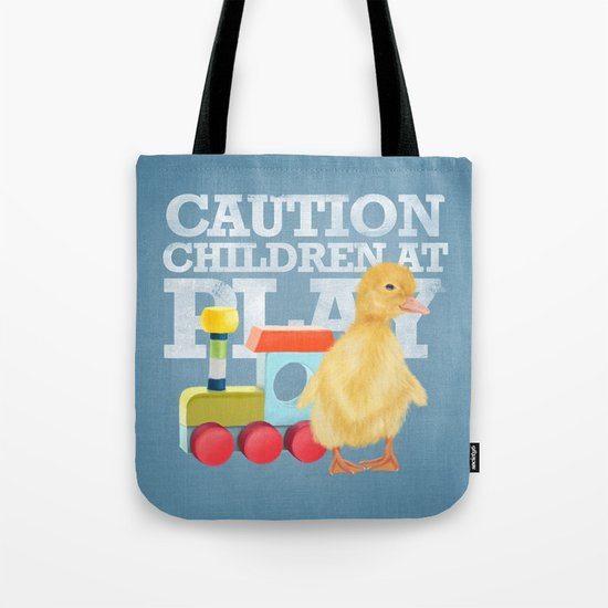 A duckling with a wood colored toy on a light blue background Tote Bag