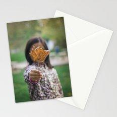 Girl holding leaf Stationery Cards