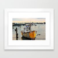 Swaying boat at sea Framed Art Print