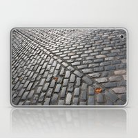 Leaves on cobblestones Laptop & iPad Skin