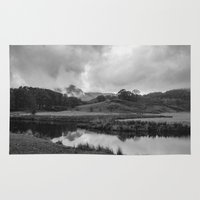 Dramatic sky and reflections on the River Brathay at Elter Water, Lake District, UK Rug