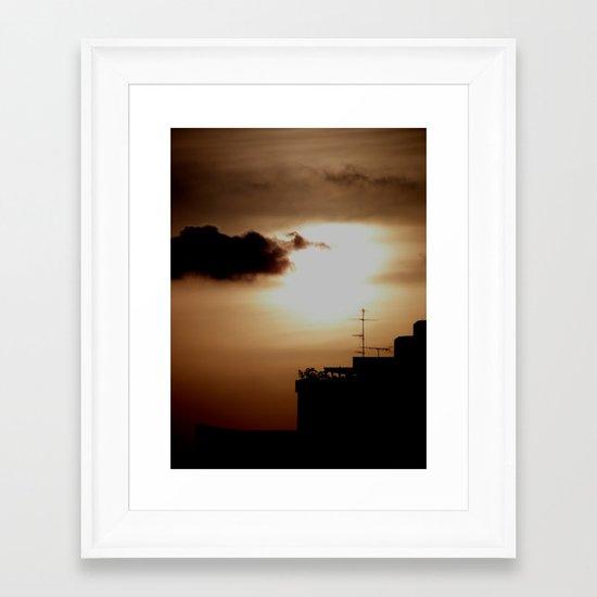 Sunset over the city Framed Art Print