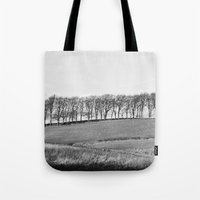 Trees on the horizon of a hill. Derbyshire, UK. Tote Bag