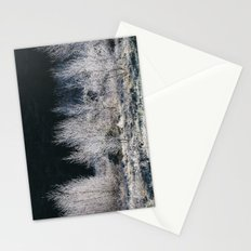 Young trees covered in a thick white frost. Norfolk, UK. Stationery Cards