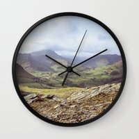 View of mountains on a sunny day. Cumbria, UK. (Shot on film). Wall Clock