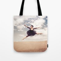Beautiful Ballet Dancer Leaping Through The Sky Over The Desert  Tote Bag
