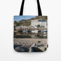 Boats moored in the harbour at Seaton. Devon, UK. Tote Bag