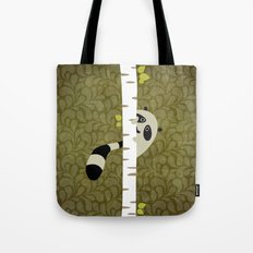 A shy raccoon Tote Bag