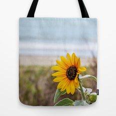 Sunflower near ocean Tote Bag
