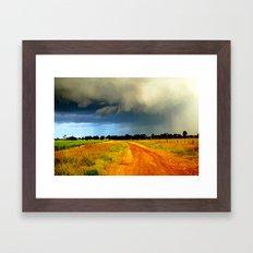 Tracking a Storm Framed Art Print