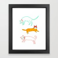 Lying Cats Framed Art Print