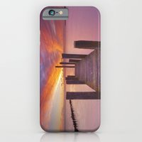 iPhone Cases featuring Seaside jetty at sunrise on Texel island, The Netherlands by Sara Winter
