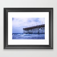 Waves Against The Pier Framed Art Print