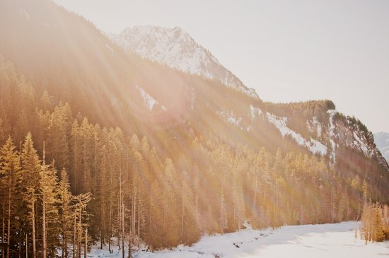 Sun Shining through the Mountains Art Print