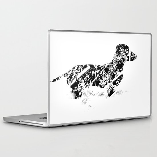 Dachshund in the snow Laptop & iPad Skin
