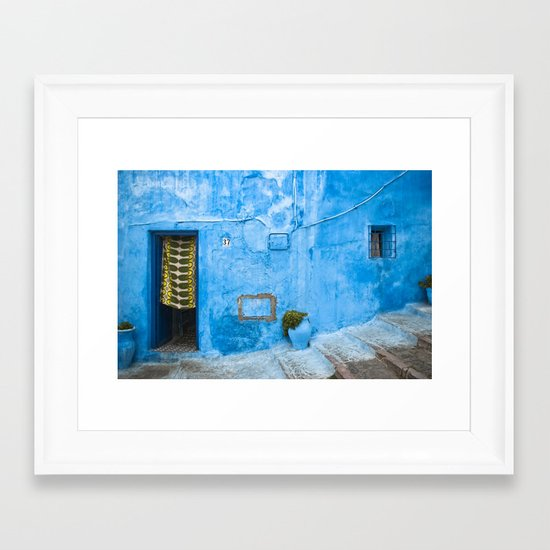 Moroccan House with Blue Wall and Green Curtain. Framed Art Print