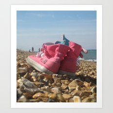 Pink shoes relaxing on the beach Art Print