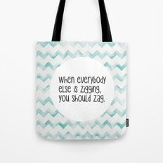 When everybody else is zigging, you should zag. Tote Bag