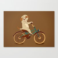 Puppy on the bike Canvas Print