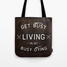 Get Busy Living Or Get B… Tote Bag