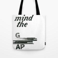 mind the gap Tote Bag