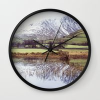 Farm and snow covered mountain reflections in Brothers Water. Cumbria, UK. (Shot on film). Wall Clock