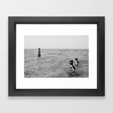 girls swimming in the sea Framed Art Print