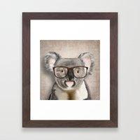 A Baby Koala With Glasse… Framed Art Print