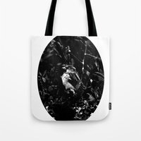 on the side of the bird's eye Tote Bag