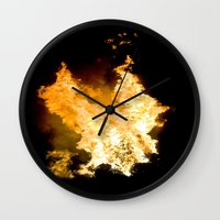 Face in the Flames Wall Clock