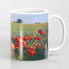 Poppies growing wild in a field of rapeseed. Castle Acre, Norfolk, UK. Mug