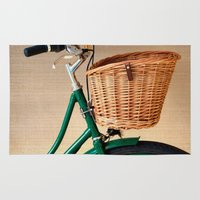 Vintage green bicycle with basket and textured background  Rug